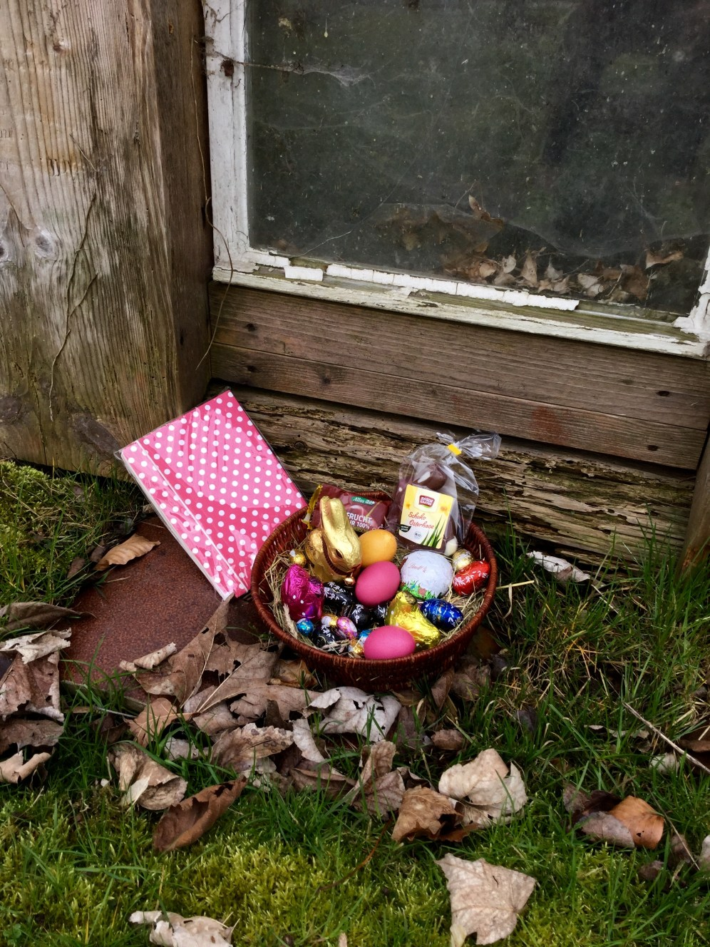 Easter nest with chocolate bunny and eggs